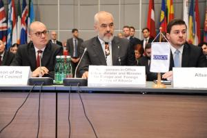 OSCE Chairperson-in-Office, Albania's Prime Minister and Minister for Europe and Foreign Affairs, Edi Rama, addresses the OSCE Permanent Council, with Acting Minister for Europe and Foreign Affairs, Gent Cakaj (r), and Ambassador Igli Hasani, Chair of the Permanent Council (l), Vienna, 9 January 2020. (OSCE/Micky Kroell)