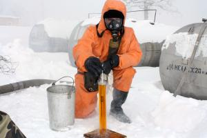 A member of the Ukrainian military takes a sample of the toxic rocket fuel component melange at the depot in Radekhiv, Ivano-Frankivsk region of Ukraine, before it is shipped for disposal, 17 February 2010. (OSCE/Leonid Kalashnyk)