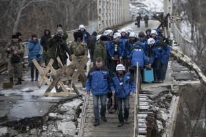 OSCE SMM monitors crossing a bridge in Stanystia Luhanska, 16 January 2016.  (OSCE/Evgeniy Maloletka)