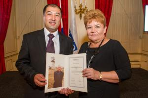 Winners of the Max van der Stoel Award, Valentina Gritsenko (r), Director of human rights NGO Spravedlivost, and Utkir Dhzabbarov (l), Senior Lawyer of Spravedlivost, The Hague, 2 October 2014. (OSCE/Arnaud Roelofsz)