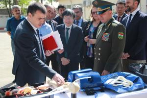 Vyacheslav Abramets, Border Management Adviser at the OSCE Office's Politico-Military Department (l), presenting the displayed equipment used during a course under the Patrol Programming and Leadership Project, Gissar Training Centre, 15 September 2017.  (OSCE/Munira Shoinbekova)