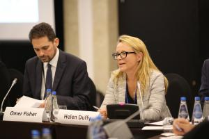 Helen Duffy, the lead consultant for the research and drafting of the publication, speaks at its launch event, held on the sidelines of the 2018 Human Dimension Implementation Meeting, as Omer Fisher, Head of the ODIHR Human Rights Department, listens. Warsaw, 12 September 2018. (OSCE/Maria Kuchma)