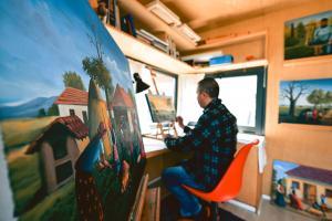 Bajram Mehmeti works in his studio ahead of the exhibition, Lepi/Lepina village, Gračanica/Graçanicë municipality, 1 April 2021  (OSCE/Yllka Fetahaj)