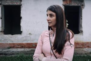 "Evelin Kecskés, an activist from the Hungarian NGO Roma Civil Rights Movement, speaks about evections in the ""Numbered Streets"" area of Miskolc, Hungary. (OSCE/Bogdan ILIESIU and Andrei CRISAN)"
