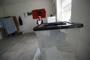 An Albanian woman prepares to cast her vote at the polling station, north of Tirana (REUTERS/Oleg Popov)
