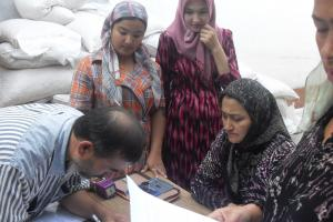 Mediator Abdullaeva Zahida (second from the left) conducts a meeting with residents of the Osh neighbourhood Teshik Tash, which was severely affected by the June 2010 violence, to resolve a dispute about distribution of humanitarian aid.  (IRET)