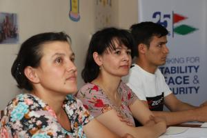 Gulrukhsor Meliboeva (centre), like other participants, was unaware of her rights as someone who has a disability, and in her case, what she was entitled to as a single mother, Khujand, 4 July 2019.  (OSCE/Farhod Nabiyulloev)