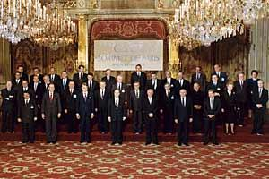 Heads of State or Government of CSCE participating States stand for a group photo at the Paris Summit, Palais de L'Elysee, 19 November 1990. (George Bush Presidential Library)